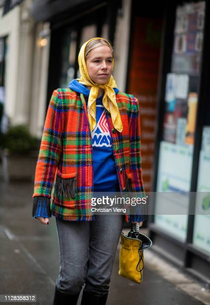 Chloe King is seen wearing head scarf, plaid jacket, blue hoody outside Nanushka during New York Fashion Week Autumn Winter 2019 on February 08, 2019...