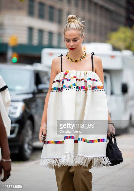 Chloe King is seen wearing off shoulder dress outside Sally LaPointe during New York Fashion Week September 2019 on September 10, 2019 in New York...