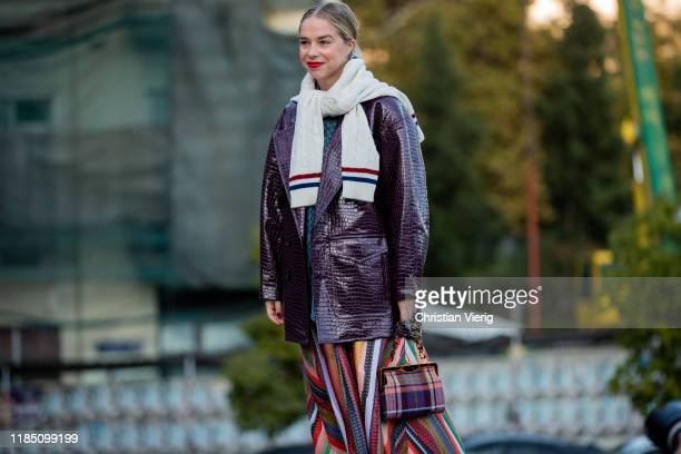 Chloe King seen wearing checked bag striped mulit colored skirt during day 3 of the MercedesBenz Tbilisi Fashion Week on November 02 2019 in Tbilisi...
