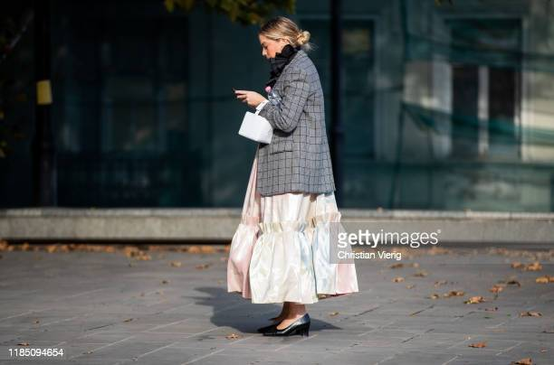 Chloe King seen wearing white bag, grey plaid blazer jacket, dress during day 3 of the Mercedes-Benz Tbilisi Fashion Week on November 02, 2019 in...
