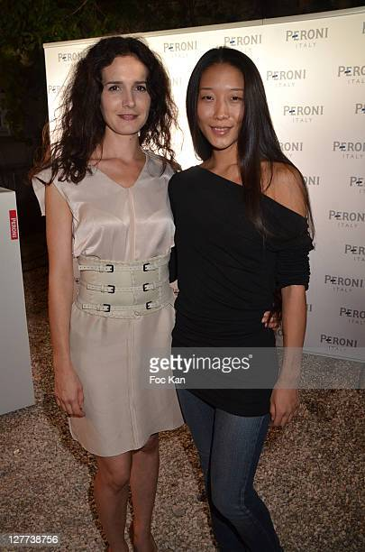 Chloe Lambert and YiQin Yin attend the Peroni Nastro Azzuro Beer Cocktail Party at the Italian Embassy on September 29 2011 Paris France
