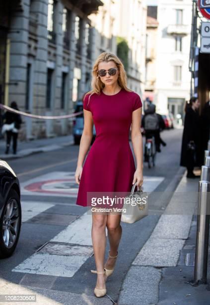 Chloe Lecareux is seen wearing bordeaux dress, Bally bag outside Bally during Milan Fashion Week Fall/Winter 2020-2021 on February 22, 2020 in Milan,...