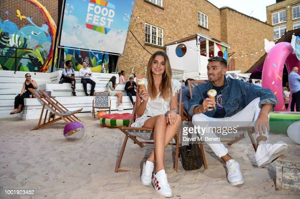 Chloe Lloyd and Josh Cuthbert pictured at the VIP launch of Just Eat Food Fest Fantasy Fusions at Last Days of Shoreditch on July 19 2018 in London...