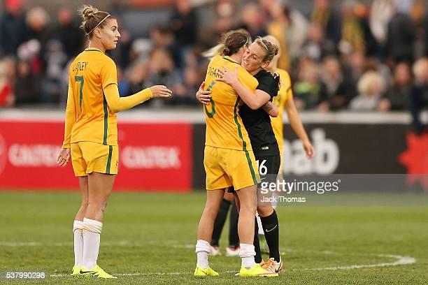 Chloe Logarzo of Australia hugs Rebekah Stott of New Zealand after the women's international friendly match between the Australian Matildas and the...
