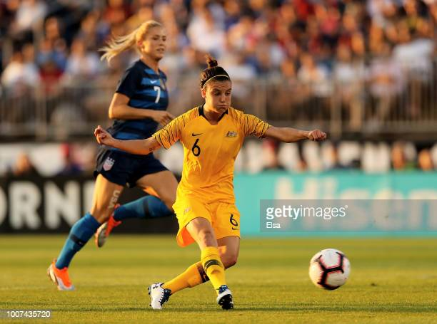 Chloe Logarzo of Australia kicks to score a goal as Abby Dahlkemper of the United States defends in the first half during the 2018 Tournament of...