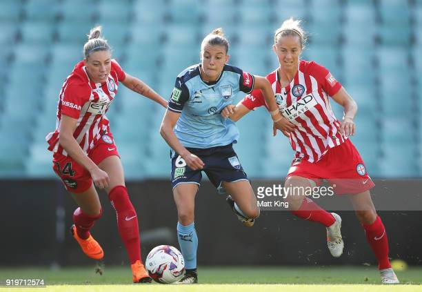Chloe Logarzo of Sydney FC is challenged by Alanna Kennedy and Aivi Luik of Melbourne City during the WLeague Grand Final match between Sydney FC and...