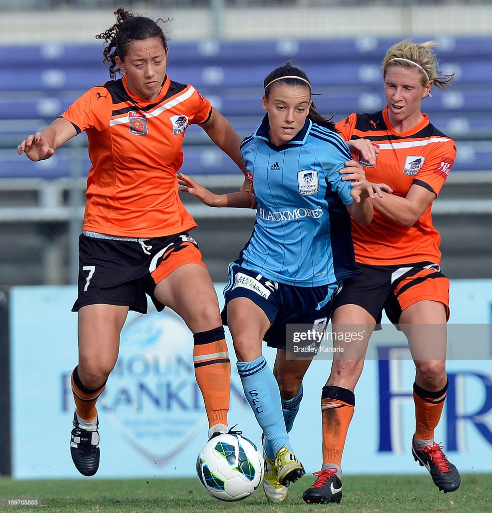 Chloe Logarzo of Sydney is pressured by the Roar defence during the W-League Semi Final match between the Brisbane Roar and Sydney FC at Queensland Sport and Athletics Centre on January 19, 2013 in Brisbane, Australia.