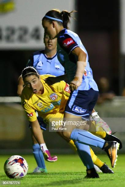 Chloe Logarzo of Sydney runs onto the ball past Gabby Dal Busco of the Perth Glory to score during the round 11 WLeague match between the Perth Glory...