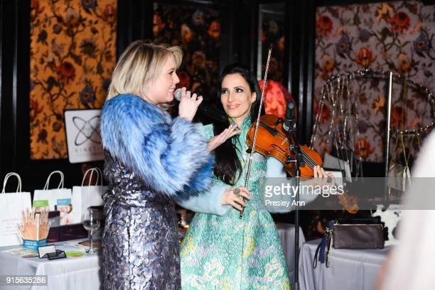 Chloe Lowery and Asha Mevlana attend Leesa Rowland's Animal Ashram PopUp Penthouse on February 7 2018 in New York City
