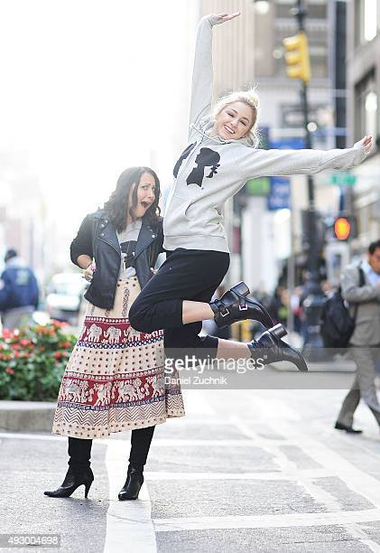 Chloe Lukasiak poses with Stacy Igel while visiting Stacy Igel at Boy Meets Girl on October 16 2015 in New York City