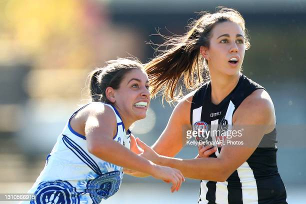 Chloe Molloy of the Magpies and Vivien Saad of the Kangaroos compete for the ball during the AFLW Finals Series match between the Collingwood Magpies...