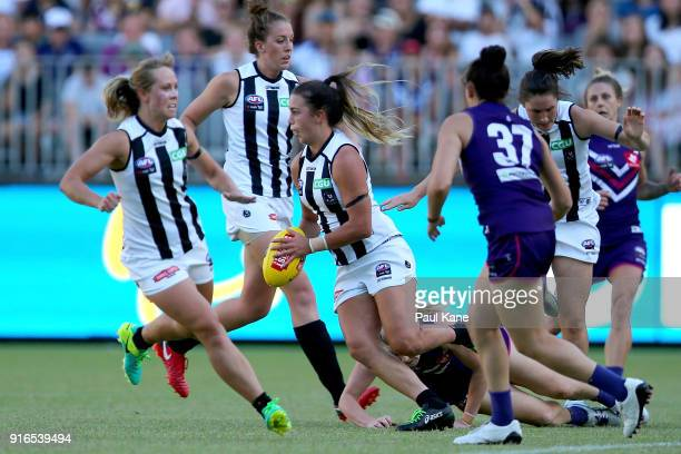 Chloe Molloy of the Magpies looks to pass the ball during the round two AFLW match between the Fremantle Dockers and the Collingwood Magpies at Optus...