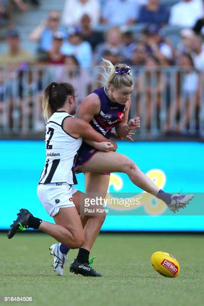 Chloe Molloy of the Magpies tackles Hayley Miller of the Dockers during the round two AFLW match between the Fremantle Dockers and the Collingwood...