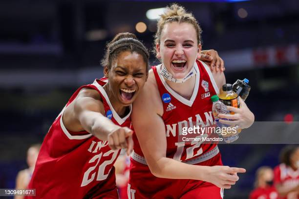 Chloe Moore-McNeil and Paige Price of the Indiana Hoosiers celebrate defeating the NC State Wolfpack 73-70 during the second half in the Sweet...