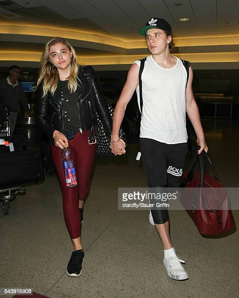 Chloe Moretz and Brooklyn Beckham are seen at LAX on June 30 2016 in Los Angeles California
