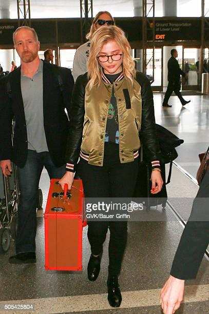 Chloe Moretz is seen at LAX on January 17 2016 in Los Angeles California
