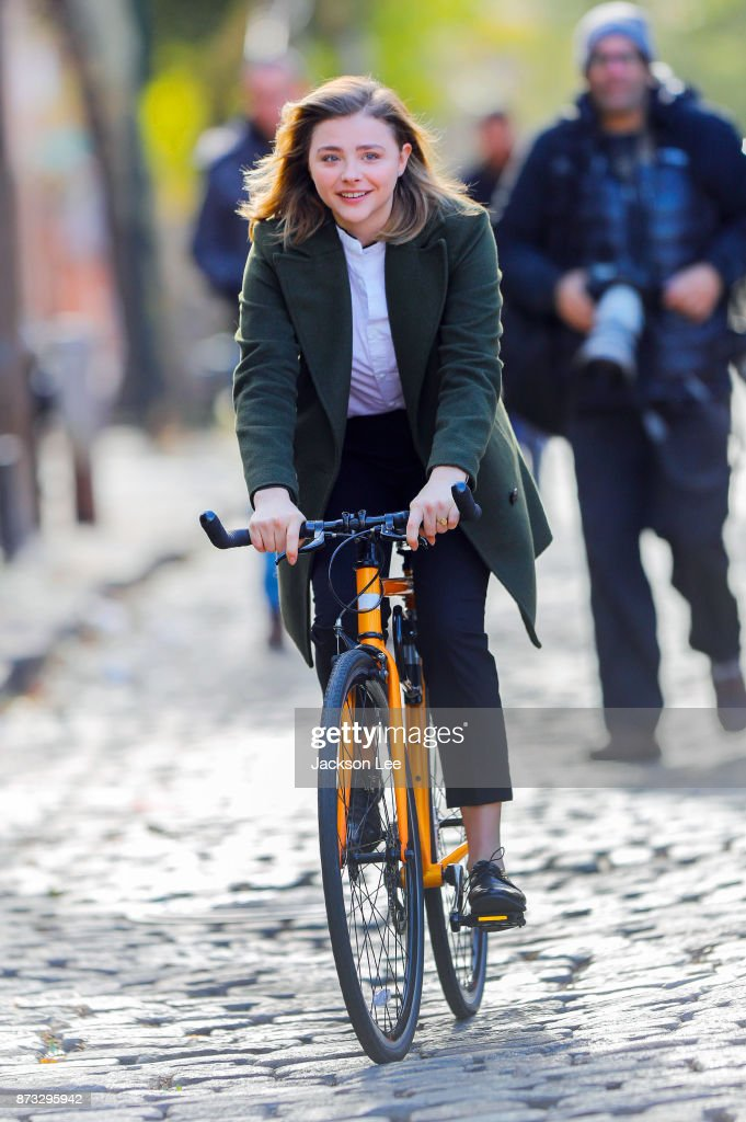 Chloe Moretz happily cycled through Brooklyn filming 'The Widow' last Sunday.