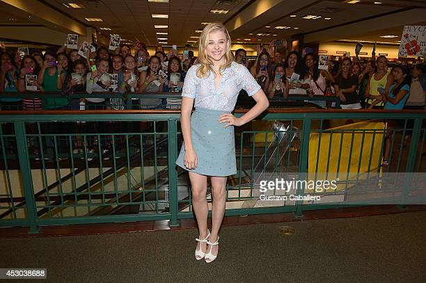 Chloe Moretz signs copies of the book If I Stay at Barnes Noble on August 1 2014 in Miami Florida