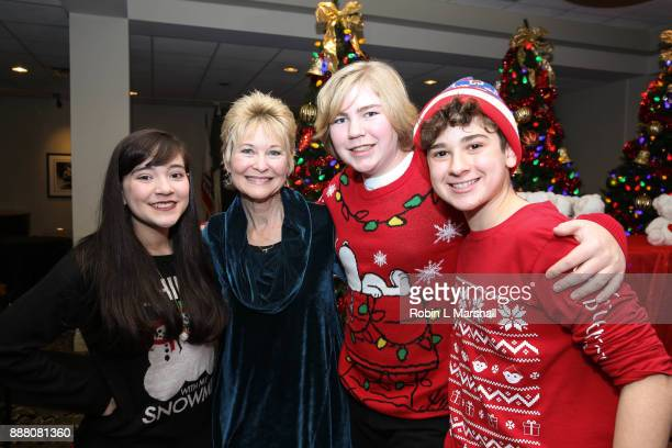 Chloe Noelle Dee Wallace Connor Dean and Jax Malcolm attend the Holiday Tour of the Hollywood Museum at The Hollywood Museum on December 7 2017 in...