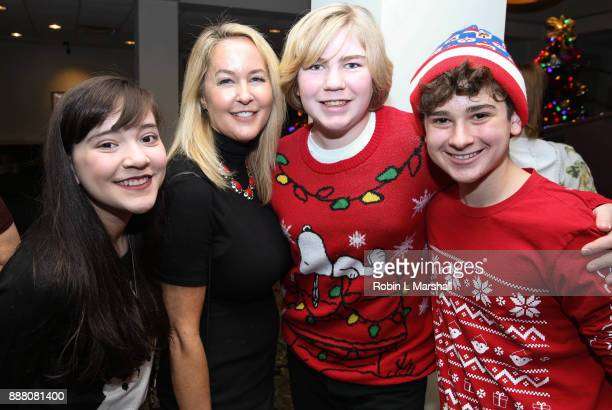Chloe Noelle Erin Murphy Connor Dean and Jax Malcolm attend the Holiday Tour of the Hollywood Museum at The Hollywood Museum on December 7 2017 in...