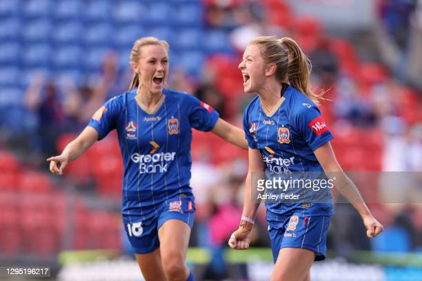 Chloe O'Brien of the Jets celebrates her goal assist with team mate Taren King of the Jets during the round two W-League match between the Newcastle...