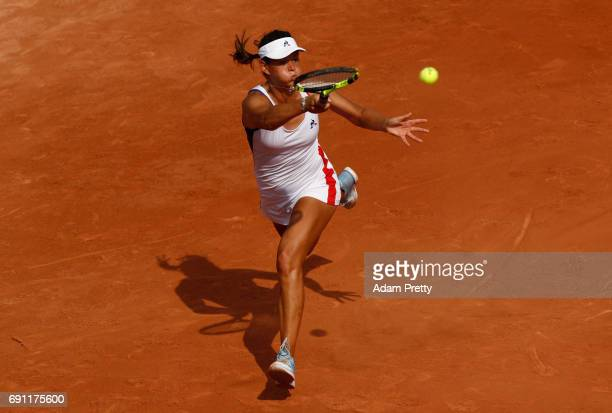 Chloe Paquet of France hits a forehand during the ladies singles second round match against Caroline Garcia of France on day five of the 2017 French...