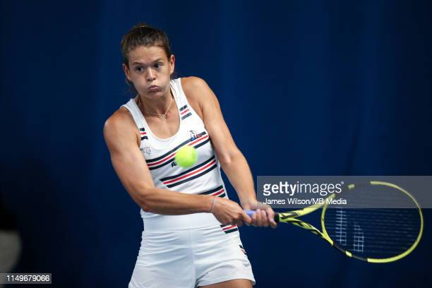 Chloe Paquet of France in action against Donna Vekic of Croatia during day four of the Nature Valley Open at Nottingham Tennis Centre on June 13 2019...