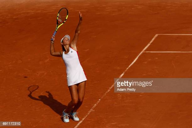 Chloe Paquet of France serves during the ladies singles second round match against Caroline Garcia of France on day five of the 2017 French Open at...