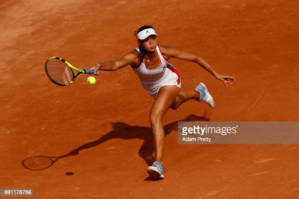 Chloe Paquet of France stretches to hit a forehand during the ladies singles second round match against Caroline Garcia of France on day five of the...