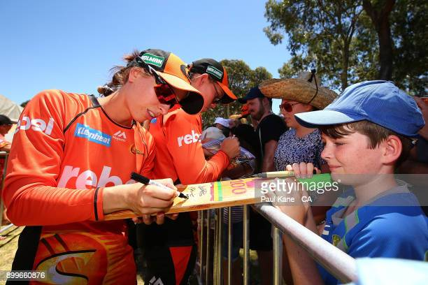 Chloe Piparo of the Scorchers signs autographs after the Women's Big Bash League match between the Sydney Sixers and the Perth Scorchers at Lilac...