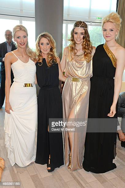 Chloe Roberts Camille Marchetti Paola Ruiz and Emilia Pikkarainen attend the Amber Lounge 2014 Gala at Le Meridien Beach Plaza Hotel on May 23 2014...