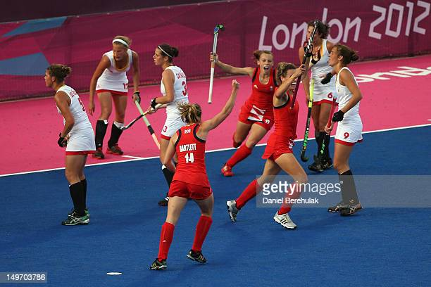 Chloe Rogers of Great Brtain celebrates scoring a goal with her team mates in the Women's Hockey preliminary match between Belgium and Great Britain...