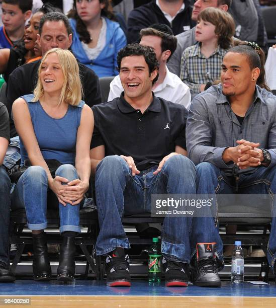 Chloe Sevigny Mark Sanchez and Dustin Keller attend a game between the Miami Heat and the New York Knicks at Madison Square Garden on April 11 2010...