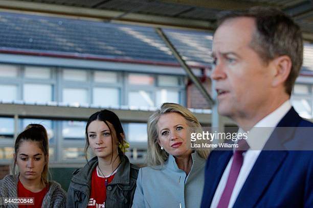 Chloe Shorten looks on as Opposition Leader Australian Labor Party Bill Shorten speaks with the media during a visit to a polling booth at Colyton on...