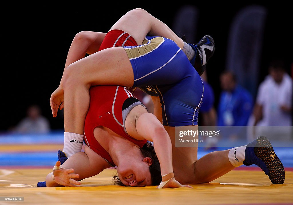 Chloe Spiteri of Great Britain is held by Ekaterine Bukina of Russia in the Women's Freestyle 72kg bout during the Wrestling LOCOG Test Event for London 2012 at ExCel on December 11, 2011 in London, England.