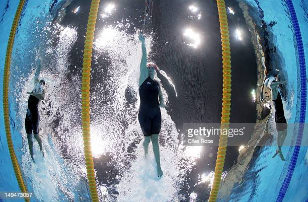Chloe Sutton of the United States Rebecca Adlington of Great Britain and Xuanxu Li of China compete in the Women's 400m Freestyle heat 3 on Day 2 of...