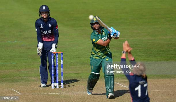 Chloe Tryon of South Africa bats as Danielle Hazell of England attempts to stop the ball during the ICC Women's World Cup 2017 match between England...