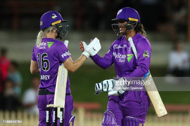 Chloe Tryon of the Hurricanes and Nicola Carey of the Hurricanes celebrate winning the Women's Big Bash League match between the Hobart Hurricanes...