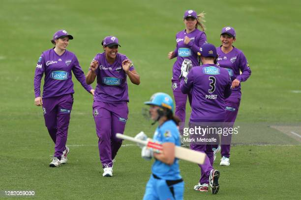 Chloe Tryon of the Hurricanes celebrates bowling out Tahlia McGrath of the Strikers during the Women's Big Bash League match between the Adelaide...