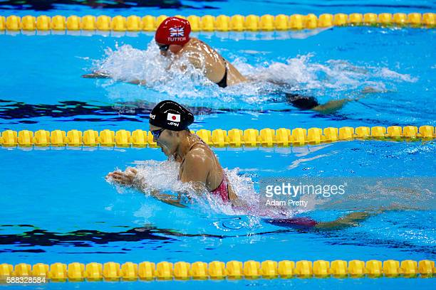 Chloe Tutton of Great Britain and Rie Kaneto of Japan compete in the first Semifinal of the Women's 200m Breaststroke on Day 5 of the Rio 2016...