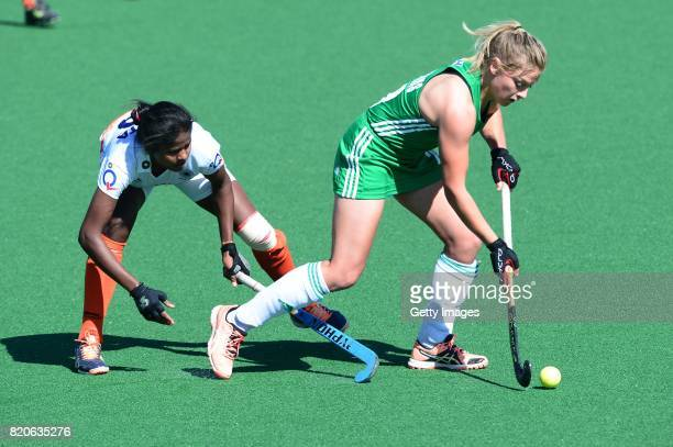 Chloe Wathins of Ireland tackled by Namita Toppo of India during day 8 of the FIH Hockey World League Women's Semi Finals 7th8th place match between...