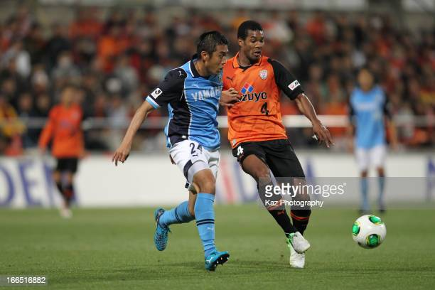 Cho Byung Kuk of Jubilo Iwata and Calvin JongaPin of Shimizu SPulse compete for the ball during the JLeague match between Shimizu SPulse and Jubilo...