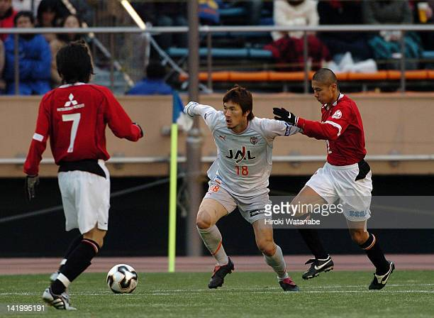 Cho Jae Jin of Shimizu SPulse and Keisuke Tsuboi of Urawa Red Diamonds compete for the ball during the 85th Emperor's Cup final match between Urawa...