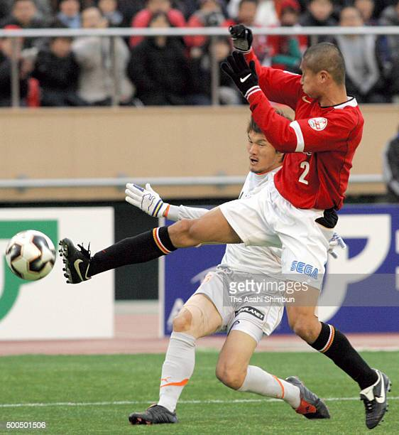 Cho Jaejin of Shimizu SPulse shoots at goal while Keisuke Tsuboi of Urawa Red Diamonds attempts to block during the 85th Emperor's Cup final match...
