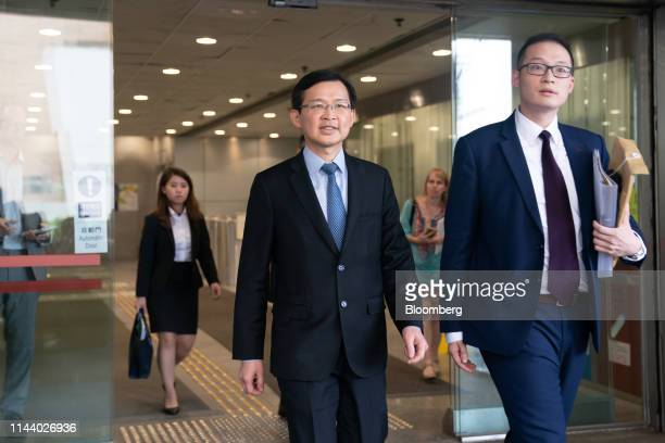 Cho Kwai-chee, founder of Town Health International Medical Group Ltd. And former director of Convoy Global Holdings Ltd., center, leaves the Eastern...