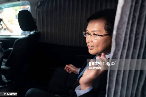 Cho Kwai-chee, founder of Town Health International Medical Group Ltd. And former director of Convoy Global Holdings Ltd., sits in a vehicle as he...