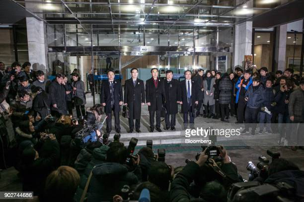 Cho Myounggyon South Korea's unification minister center and delegates pose for photographs before departing from the Office of InterKorean Dialogue...