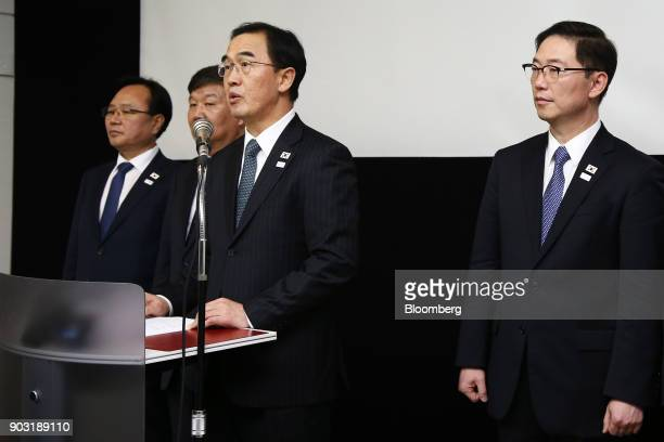 Cho Myounggyon South Korea's unification minister center left speaks after a meeting with North Korean delegates in the village of Panmunjom in the...