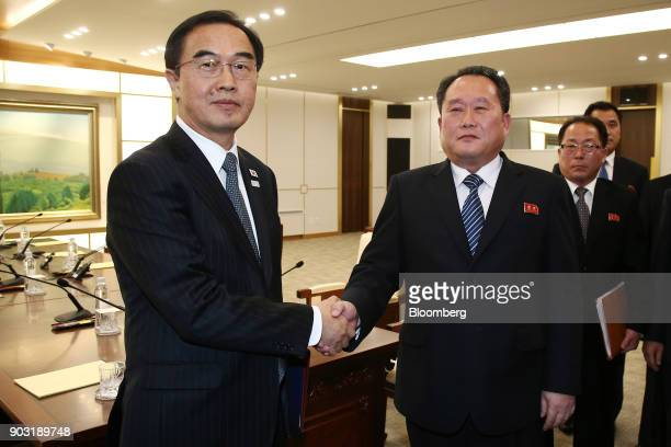 Cho Myounggyon South Korea's unification minister left and Ri Son Gwon chairman of North Koreas Committee for the Peaceful Reunification of the...