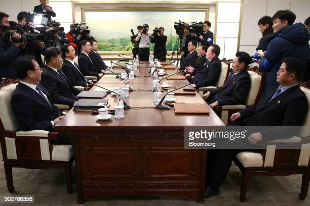 Cho Myounggyon South Korea's unification minister seated third left Ri Son Gwon chairman of North Koreas Committee for the Peaceful Reunification of...